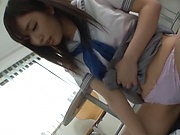 Young Japanese schoolgirl gives a steamy handjob