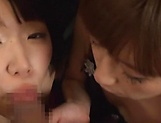 Two horny Asian teens give a sizzling POV blowjob picture 12