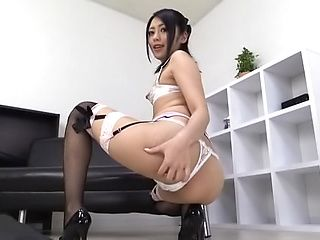 Sassy milf in stockings masturbating solo