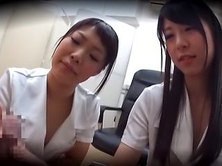 Beautiful Asian nurses in kinky hand job scene indoors